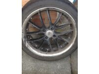 For sale 4 black alloy wheels with silver trim 3 have tyres with good tread