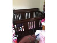 Solid wood sleigh style cot