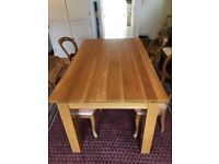 Solid chunky oak dining table with 4 chairs