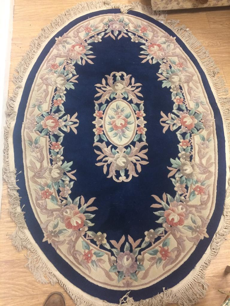 Large oval Oriental style rug