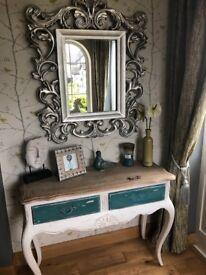 Ornate looking sliver mirror