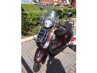 Piaggio Vespa Touring, maroon, 50cc good conditn, two perfect helmets, lady's gloves & biker jacket