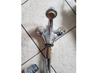 Chrome and gold basin taps with waste .