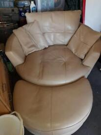 Luxurious leather swivel chair and foot stool