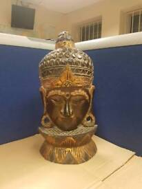 50x26x10 wooden buddha head statue. Hand made it has a few craks but still in very good condition