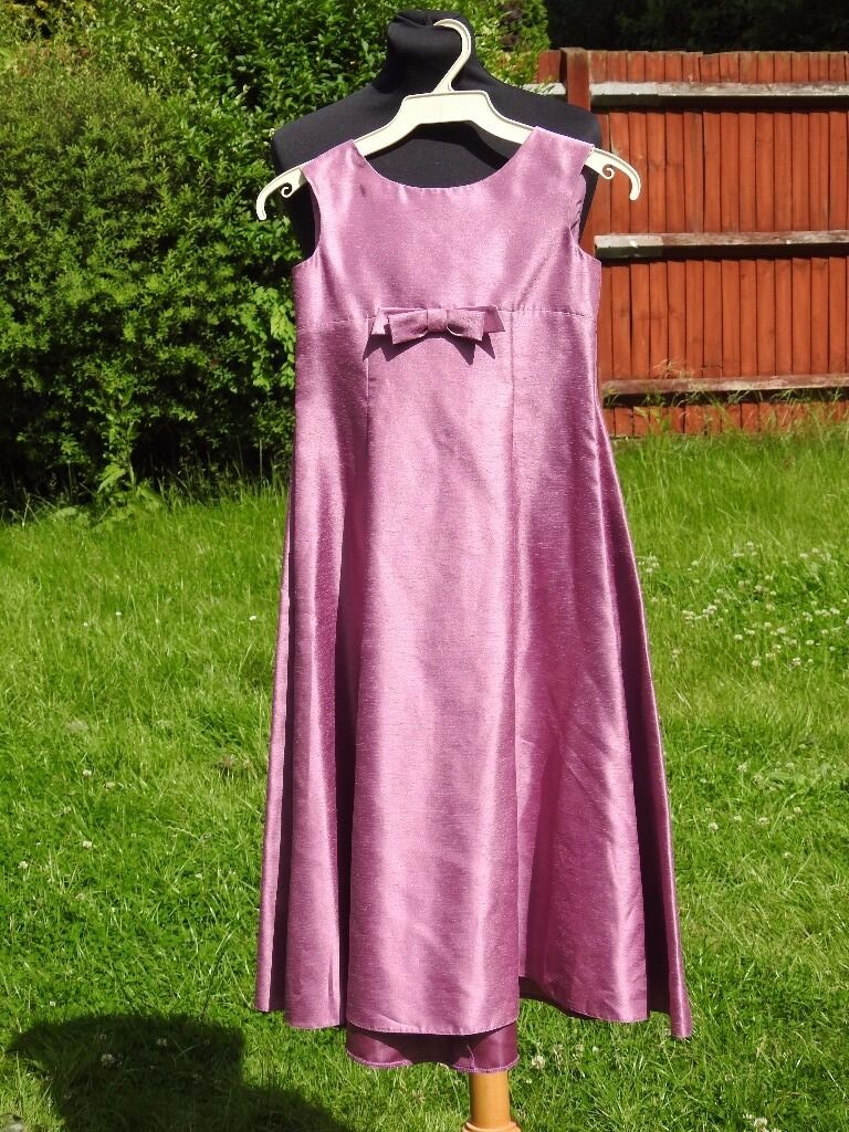 Stunning Kelsey Rose Pink Purple Bridesmaid Part Formal Dress 9 10 Years 70cm Chestin Emerson Valley, BuckinghamshireGumtree - Stunning Kelsey Rose Pink Purple Bridesmaid Party Dress 9 10 Years 70cm Chest Gorgeous One of a kind handmade garment Beautiful Wedding/ Bridesmaid/ Occasion Dress New Without Tags Age 9 10 A Stunning Dress With Beautiful bow detail on front All...