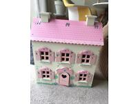 Child's wooden doll house