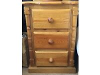 pair of as new solid pine bedside cabinets