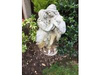Lovely garden statue of couple holding each other