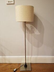 Adjustable floor lamp with cream shade