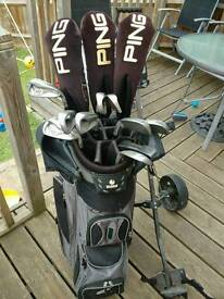 Full set of mens right handed golf clubs and trolley