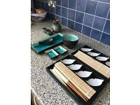 Asian serving items - sushi, saki, chopsticks