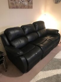 *need gone ASAP* lowered asking price! Black leather reclining sofa. Leather comfortable Paid £1000.