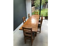 Solid wood dining table (with 2 extension pieces) and 6 chairs
