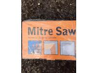 Mitre saw. 11 pre-set mitres. Brand new