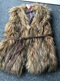 Ladies fake fur gillet, brand new with tags, size12/14,