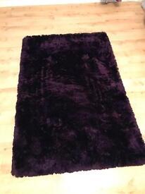 Medium sized purple rug