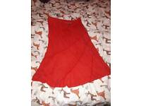 Pretty flared red skirt with curved trim size 16