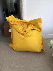 Large yellow beanbag