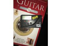 Various guitar learning books and accessories.