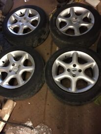 Genuine Mazda 323 set of alloy wheels and tyres