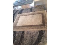 Beige/Sand coloured rug