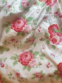 Floral curtains with polka dot lining