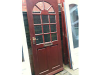 Exterior hardwood door with frosted glass squares
