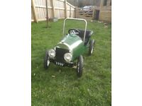 Great Gizmo Classic Green Pedal Car. Made in metal, very sturdy and in good condition