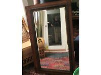 Large wooden mirror for sale, carved frame bevelled glass. 112cm x 68cm x 2.5cm. Has a vintage feel.