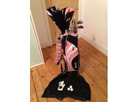 Barely used pink RAM golf bag, balls, clubs, club head covers, ladies glove and bag hood.