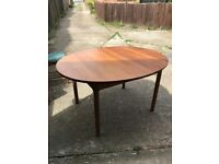 Ercol Pine Dining Table plus two ladder back chairs