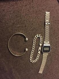 Silver bracelets and watch