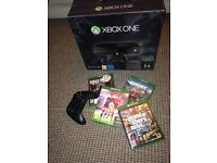 Xbox one in box with games (ono)