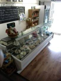 Large deli counter and tall fridge