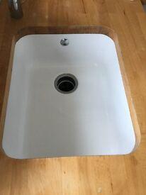 kohler ceraic sink with waste disposal aperture