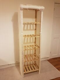 Pine shelving unit with canvas cover and five shelves