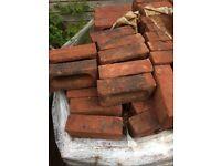 300 dark red bricks £120