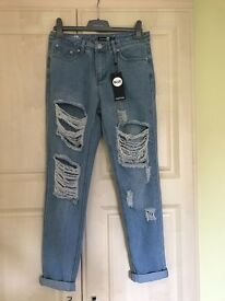 Women's Boohoo Ripped Boyfriend Jeans size 8. Never worn!!