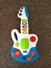 Chicco plastic toy guitar, with light up buttons and sounds.