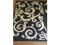 Black and cream pattern rug