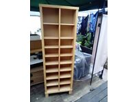 Free standing unit with adjustable shelves