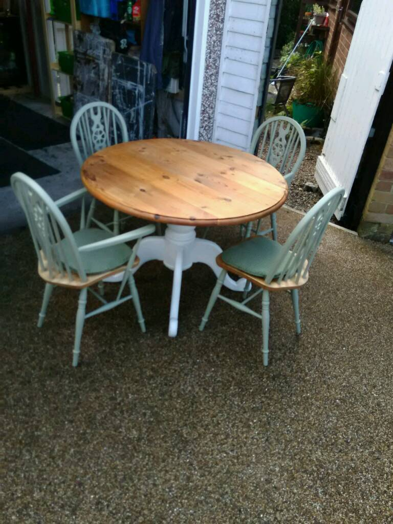 SOLID PINE CIRCULAR DROP LEAF TABLE WITH FOUR CHAIRS COULD DELIVER