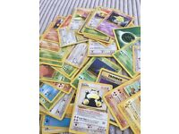 50 Pokemon cards including base set, fossil and jungle. Couple of rares!