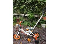Small child's bike with handle