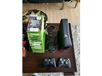 Xbox 360 slim with 18 games inc Grand theft auto V 5