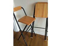 Two foldable bar stools