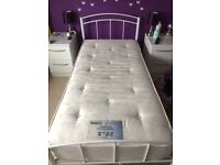 White single metal bed frame and mattress