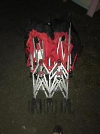 Double red pushchair