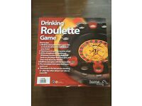 Two drinking board games including roulette